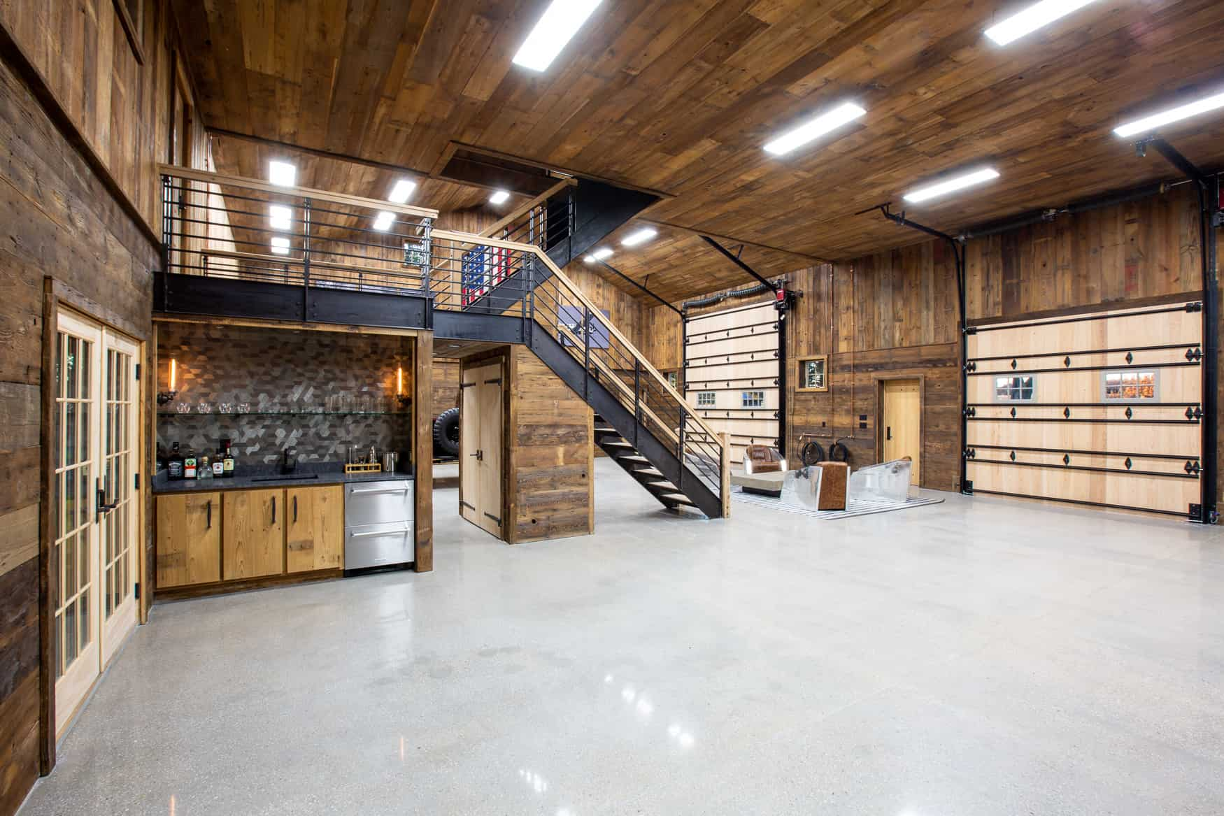 party barn interior with finished wood walls and ceiling along with grey floor