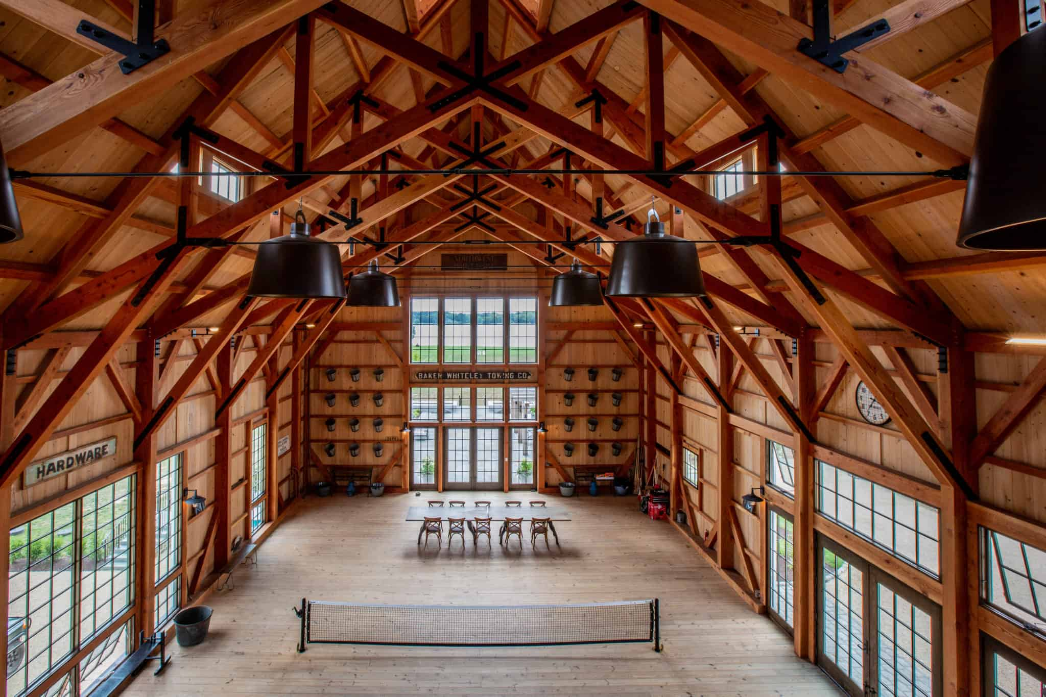 elevated view of newly built party barn with large windows and symmetrical ceiling beams